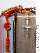 Religious symbols. Quran, bible and prayer beads. Christianity, Islam... Стоковое фото, фотограф Fred de Noyelle / Godong / age Fotostock / Фотобанк Лори