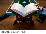 Open Quran on Muslim prayer mat at home. France. Стоковое фото, фотограф Pascal Deloche / Godong / age Fotostock / Фотобанк Лори