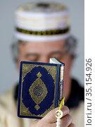 Muslim reading the Quran at home during Ramadan. France. Стоковое фото, фотограф Fred de Noyelle / Godong / age Fotostock / Фотобанк Лори