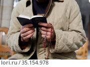 Young man reading the gospel in church, Beaumont-le-Roger, France. Стоковое фото, фотограф Julian Kumar / Godong / age Fotostock / Фотобанк Лори