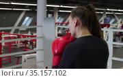 Young pretty woman training her boxing on the ring - shadow boxing. Стоковое видео, видеограф Константин Шишкин / Фотобанк Лори