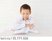 Boy doing homework. Стоковое фото, фотограф Арестов Андрей Павлович / Фотобанк Лори