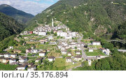 Picturesque aerial view of small Swiss village Intragna surrounded by mountains. Стоковое видео, видеограф Яков Филимонов / Фотобанк Лори