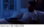indian man closing laptop in bed at home at night. Стоковое видео, видеограф Syda Productions / Фотобанк Лори