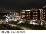 Stockholm, Sweden An apartment complex at night in Norra Djurgardsstaden... Стоковое фото, фотограф A. Farnsworth / age Fotostock / Фотобанк Лори