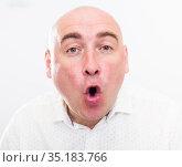 portrait of bald adult elderly man with emotions on white background. Стоковое фото, фотограф Татьяна Яцевич / Фотобанк Лори