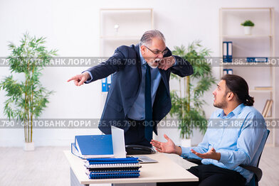 Old boss and his young assistant in the office