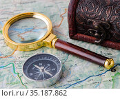 Travel concept with compass and map. Стоковое фото, фотограф Elnur / Фотобанк Лори