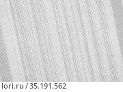 Gray textile abstract background with diagonal stripes, linen cotton fabric texture, monochrome blank with copy space. Стоковое фото, фотограф Светлана Евграфова / Фотобанк Лори