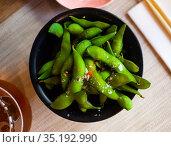 Green soy beans edamame in the bowl on table. Стоковое фото, фотограф Яков Филимонов / Фотобанк Лори