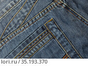 Denim abstract stitched background with pocket, blue jeans fabric texture with seams, youth concept. Стоковое фото, фотограф Светлана Евграфова / Фотобанк Лори
