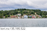 View of the old part of Flores city located on an island on Lake Peten Itza in the region of Peten Basin in northern Guatemala. Стоковое фото, фотограф Николай Коржов / Фотобанк Лори