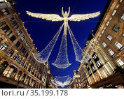 Regent Street Christmas lights, London, England, United Kingdom, ... Стоковое фото, фотограф Charles Bowman / age Fotostock / Фотобанк Лори