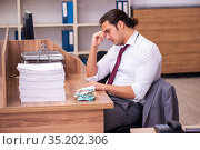 Young male employee extremely tired with excessive work. Стоковое фото, фотограф Elnur / Фотобанк Лори