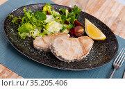 Close up of mediterranean tuna steak on plate on tablecloth. Стоковое фото, фотограф Яков Филимонов / Фотобанк Лори