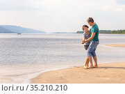 beautiful sporty mature couple dancing on the beach on the Volga river against the background of the Zhiguli mountains on a summer day. Стоковое фото, фотограф Акиньшин Владимир / Фотобанк Лори