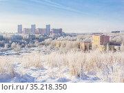 New buildings in a snowy city. Стоковое фото, фотограф Дмитрий Тищенко / Фотобанк Лори