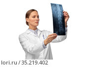 female doctor with x-ray of spine. Стоковое фото, фотограф Syda Productions / Фотобанк Лори