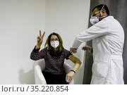 A woman during the Covid-19 vaccination in the Vaccine Center Mostra... Редакционное фото, фотограф Fabio Sasso / AGF/Fabio Sasso / AGF / age Fotostock / Фотобанк Лори