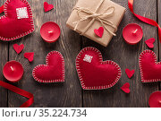 Valentine's day card. Hearts, boxes and ribbons on a background of boards. Стоковое фото, фотограф Сергей Молодиков / Фотобанк Лори