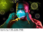 african man in respirator protecting from virus. Стоковое фото, фотограф Syda Productions / Фотобанк Лори