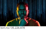 young african american man over binary code. Стоковое фото, фотограф Syda Productions / Фотобанк Лори