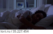 woman with smartphone in bed at home at night. Стоковое видео, видеограф Syda Productions / Фотобанк Лори