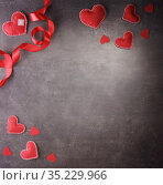 Valentine's day card. Handmade hearts and scarlet ribbon on dark background. Стоковое фото, фотограф Сергей Молодиков / Фотобанк Лори