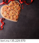 Valentine's day concept. Heart shaped pizza, red ribbon and two hearts. Top view. Стоковое фото, фотограф Сергей Молодиков / Фотобанк Лори