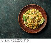 Pakistani chicken biryani rice, top view, copy space. Стоковое фото, фотограф Ольга Сергеева / Фотобанк Лори
