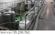 View of department of fermentation with big metal wine reservoirs. Стоковое видео, видеограф Яков Филимонов / Фотобанк Лори