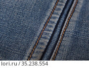 Denim with orange thread stitching. Стоковое фото, фотограф Юрий Бизгаймер / Фотобанк Лори