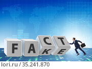 Face or fact concept with turning cubes. Стоковое фото, фотограф Elnur / Фотобанк Лори