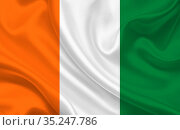 Flag of the country of Cote d'Ivoire on a background of wavy silk... Стоковое фото, фотограф Zoonar.com/Evgeny Babaylov / easy Fotostock / Фотобанк Лори