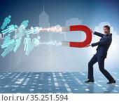 Businessman in recruitment concept with horseshoe magnet. Стоковое фото, фотограф Elnur / Фотобанк Лори