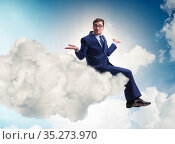 Businessman sitting on the cloud in motivitation concept. Стоковое фото, фотограф Elnur / Фотобанк Лори