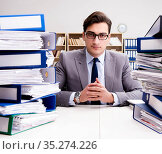 Busy businessman under stress due to excessive work. Стоковое фото, фотограф Elnur / Фотобанк Лори