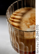close up of coffee in glass on table. Стоковое фото, фотограф Syda Productions / Фотобанк Лори