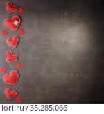 Red hearts from felt handmade on a dark background. Blank space for inscription. Стоковое фото, фотограф Сергей Молодиков / Фотобанк Лори