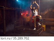 Two rappers posing, performing in cool studio. Стоковое фото, фотограф Tryapitsyn Sergiy / Фотобанк Лори