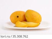 Mango fruit in basket with slice on white background. Стоковое фото, фотограф Dipak Chhagan Shelare / easy Fotostock / Фотобанк Лори