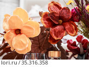 Floral background pattern of chocolate brown earthy and red color with artificial flowers large elegant in pastel tone for postcard. Стоковое фото, фотограф Светлана Евграфова / Фотобанк Лори