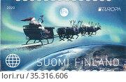 Санта Клаус на оленьей упряжке. Рождественский сюжет на почтовой марке Финляндии. Стоковая иллюстрация, иллюстратор Илюхина Наталья / Фотобанк Лори