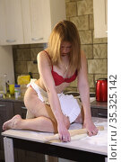 Girl in red underwear cooks in the kitchen. Стоковое фото, фотограф Марина Володько / Фотобанк Лори