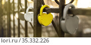 Closed padlock and heart shape as a symbol of eternal love. Concept for valentine's day. Blurred image, selective focus. Стоковое фото, фотограф Александр Сергеевич / Фотобанк Лори