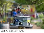 Berlin, Germany - imitation of the world time clock at Alexanderplatz in the Vattenfall city garden in Koepenicker Strasse (2018 год). Редакционное фото, агентство Caro Photoagency / Фотобанк Лори