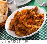 Stewed pork with braised cabbage. Стоковое фото, фотограф Яков Филимонов / Фотобанк Лори