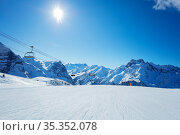Ski lift over mountain peaks panorama and trails. Стоковое фото, фотограф Сергей Новиков / Фотобанк Лори