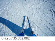 Legs and ski of mountain skier from above. Стоковое фото, фотограф Сергей Новиков / Фотобанк Лори