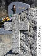 Cross on a gravestone. Passy cemetery. Haute-Savoie. Auvergne Rh™ne... Стоковое фото, фотограф Catherine Leblanc / easy Fotostock / Фотобанк Лори